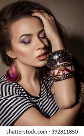Portrait of beautiful young woman with makeup