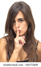 Portrait of Beautiful Young Woman Making Silence Gesture Over White Background