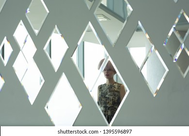 portrait of a beautiful young woman in the mirror, reflection, rhombus