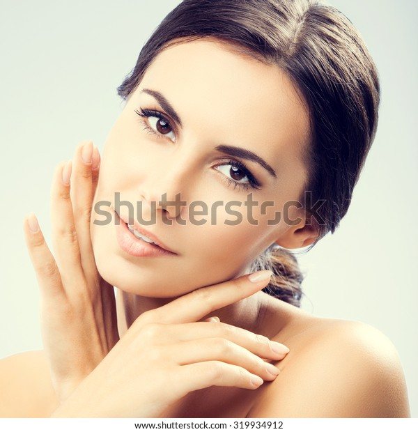 portrait of beautiful young woman with naked shoulders