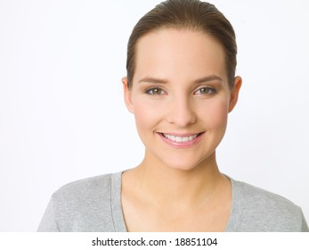 Portrait of beautiful young woman on white background