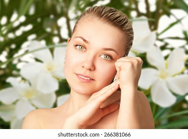 Portrait of a beautiful young woman on the floral background