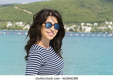 portrait of a beautiful young woman on a sea background.Summer holiday