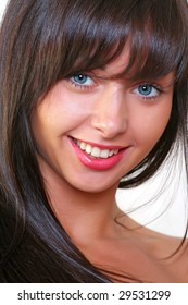 Portrait of the beautiful young woman with an open smile and blue eyes