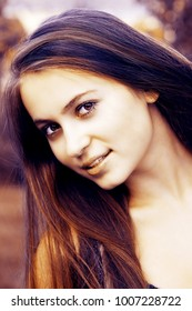 Portrait of beautiful young woman outdoor.