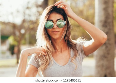 Portrait of beautiful young woman outdoors on sunny day