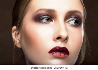 Portrait of beautiful young woman. Perfect makeup. Fashion photo