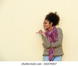 Portrait of a beautiful young woman pointing finger