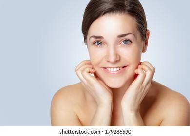 Portrait of Beautiful Young Woman posing in studio