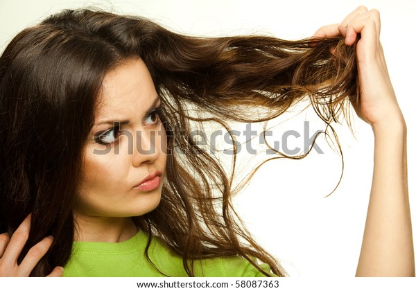 Portrait of beautiful young woman with problematic hair isolated on white.