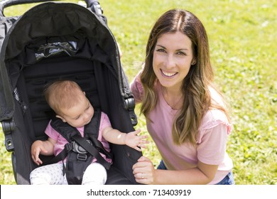 e36866609ea6 mom pushing baby stroller Images
