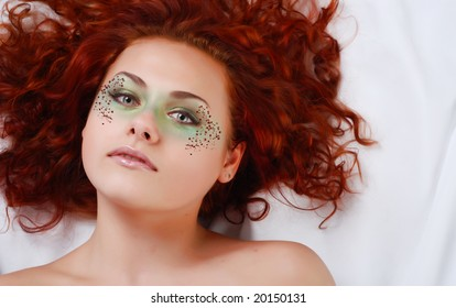 portrait of a beautiful young woman with red hair