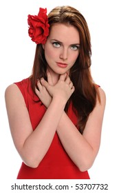 Portrait of beautiful young woman with red rose on hair