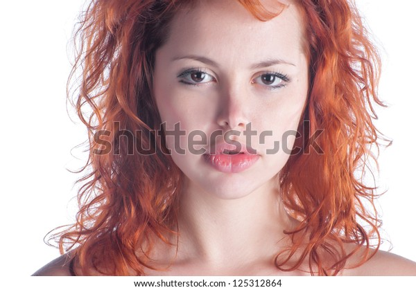 Portrait of beautiful young woman with red hair closeup on white