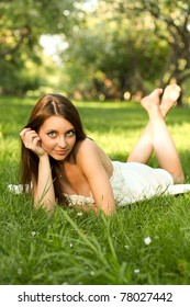 portrait of beautiful young woman relaxing in spring park