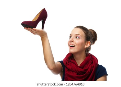 Portrait of beautiful young woman with shoe