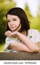portrait beautiful young woman short hair dreams green summer park