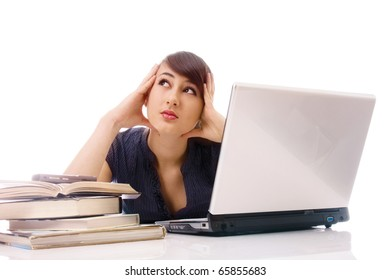 Portrait of beautiful young woman siiting at the table with laptop