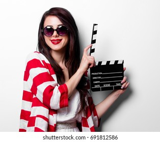 portrait of the beautiful young woman with slapstick on the white background