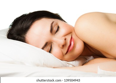 Portrait of a beautiful young woman sleeping peacefully. Isolated over white.