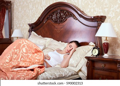 Portrait of beautiful young woman sleeping in a bed in the bedroom.