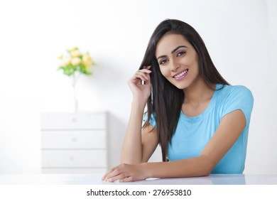 Portrait of beautiful young woman smiling at home