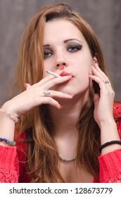Portrait of beautiful young woman smoking.