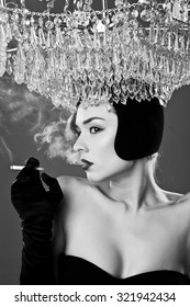 Portrait of beautiful young woman smoking cigarette on the background