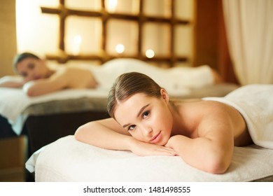 Portrait of beautiful young woman in SPA looking at camera, copy space