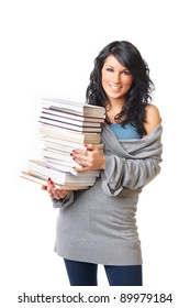 Portrait of beautiful young woman with stack of books on white background