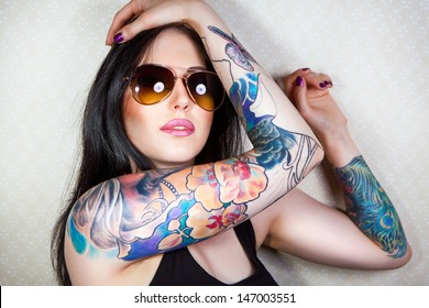 Portrait of a beautiful young woman with a tattoo