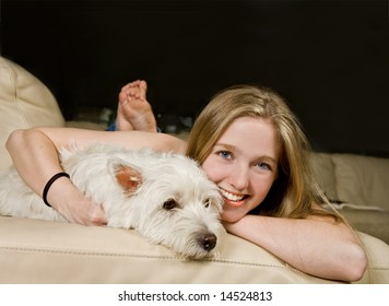 Portrait of a beautiful young woman or teenager enjoying quality time with her white West Highland Terrier