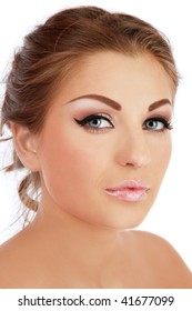 Portrait of beautiful young woman with trendy makeup