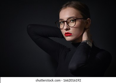 Portrait Of Beautiful Young Woman Wearing Glasses