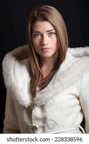 Portrait of beautiful young woman wearing winter coat