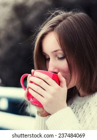 Portrait of beautiful young woman who drinking a cup of tea