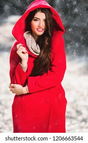 A portrait of a beautiful young woman in a winter forest. Lifestyle, autumn fashion, beauty.