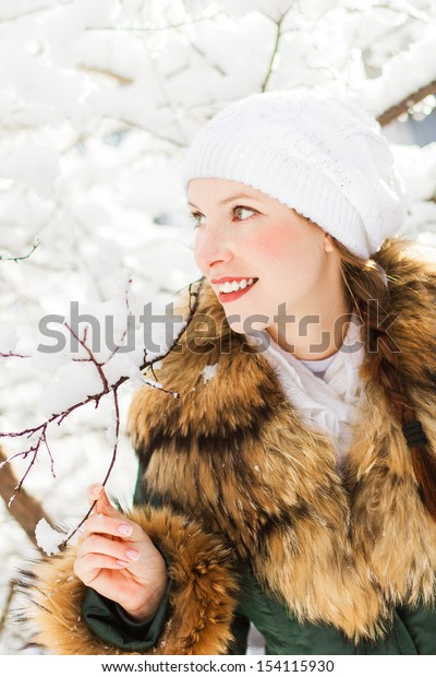 Portrait of beautiful young woman in winter day