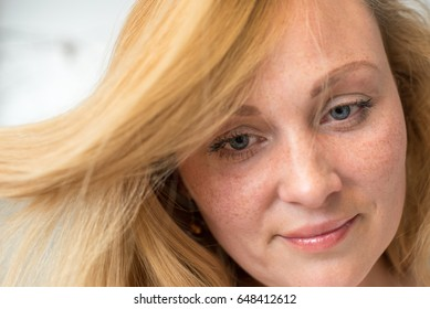 Portrait of beautiful young woman.Romantic girl with freckles and blonde hair