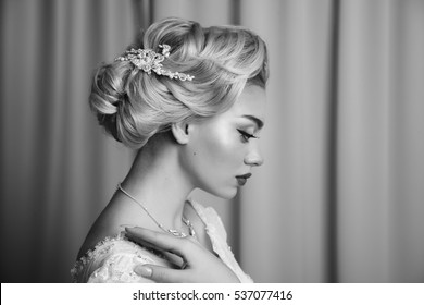 Portrait of beauty bride in white dress with classic hairstyle