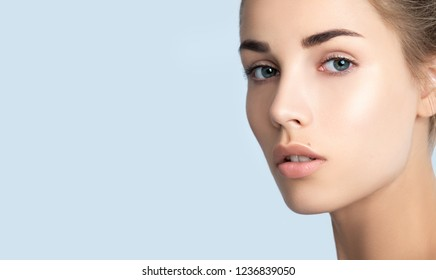 Portrait of beauty model with natural nude make up. Beautiful young woman with clean perfect skin,  close-up. Spa, skincare and wellness. Close up, background, copyspace.