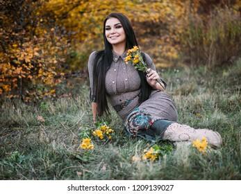 Portrait of beauty Romantic Girl Outdoors enjoying nature.
