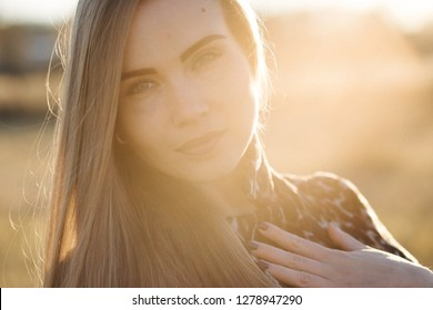 Portrait of Beauty Romantic Girl Outdoors. on the Field in Sun Light. Long Hair. Autumn.