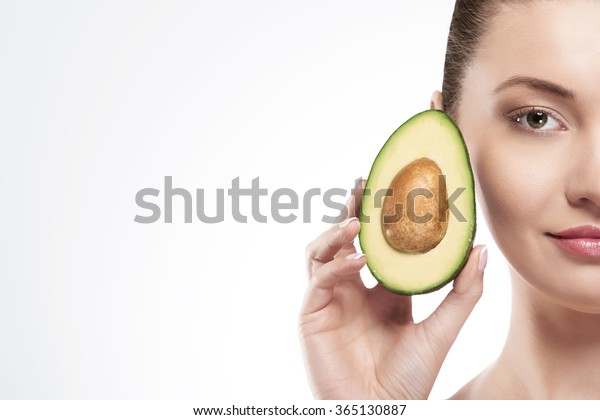 Portrait of beauty woman with avocado