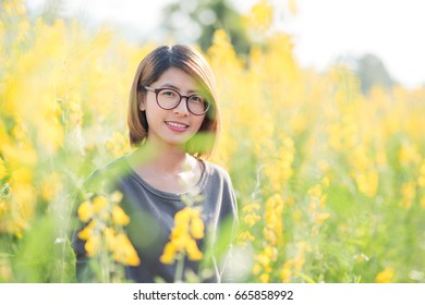Portrait of beauty woman in the Meadow.Portrait of young beautiful smiling woman outdoors.