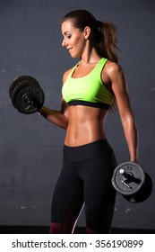 Portrait of a beauty young adult sporty attractive sexy and sensuality pretty brunette woman at the gym