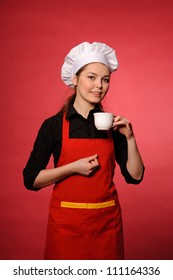 portrait of beauty young cook with hot drink