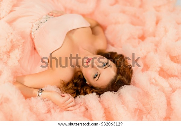 Portrait of beauty young woman in pearch dress.