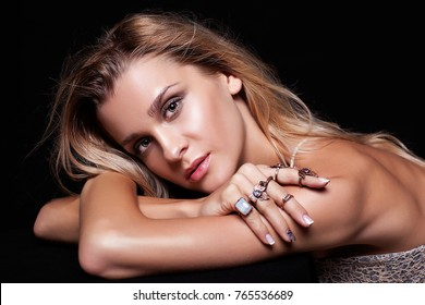 Portrait of beauty young  woman in summer casual dress with shaggy hair on black background