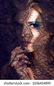 portrait of beauty young woman through lace close up mistery mak